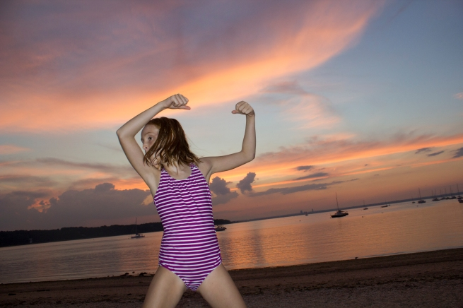 """Violet on the beach. Photo by Melanie Acevedo from Week 52 of her personal series """"52 Weeks."""""""