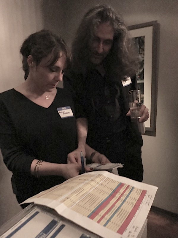 Bill reviews the guest list with Rachel Goldman, who also helped make our agency presentations during the week run smoothly.