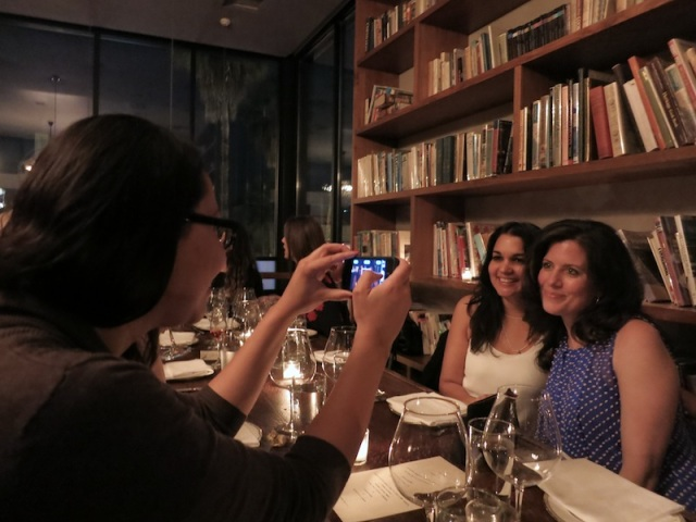 Heather Byrd Michaels taking a photo of her  TBWA\Chiat\Day colleagues Jigisha Bouverat (left) and Karen Youngs.