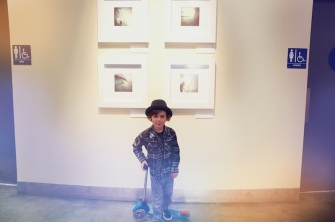 Ryder Lippman in front of his dad's work. Photo by Paulo Lemes.
