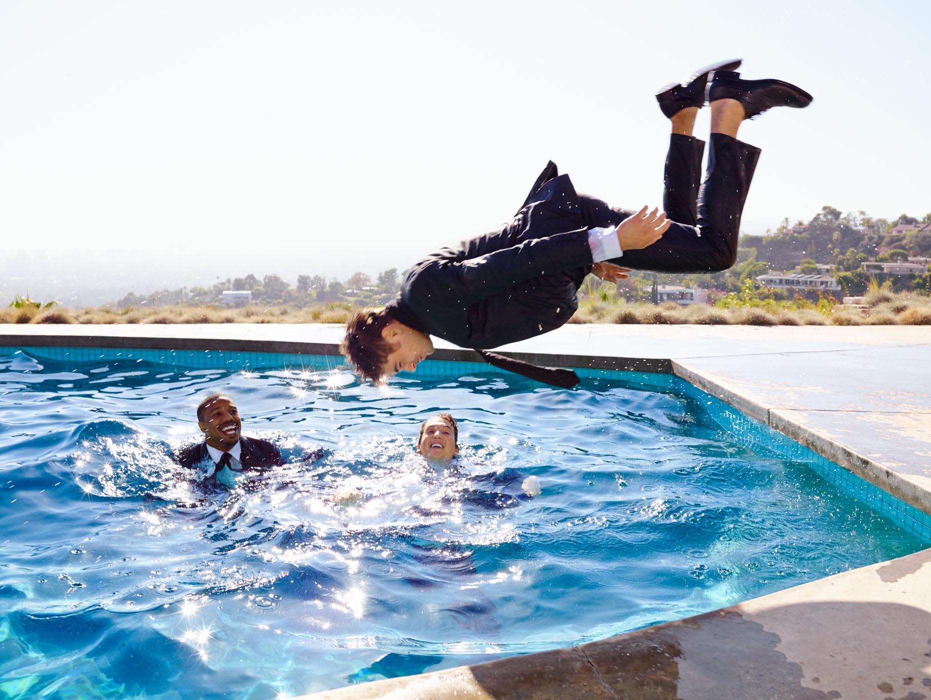 Zac efron goes swimming in a suit and tie for jeff lipsky for Latest swimming pool