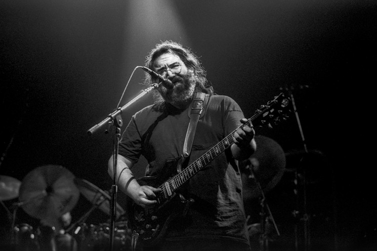 Jerry Garcia of The Grateful Dead playing a solo with the band on New Year'ls Eve at the San Francisco Civic Auditorium, circa 1981. ©Doug Menuez