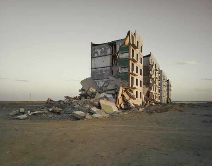 Nadav Kander, The Aral Sea I (Officer's Housing), Kazakhstan, 2011. Chromogenic print, 48 3/8 x 58 5/8 in., edition 5.