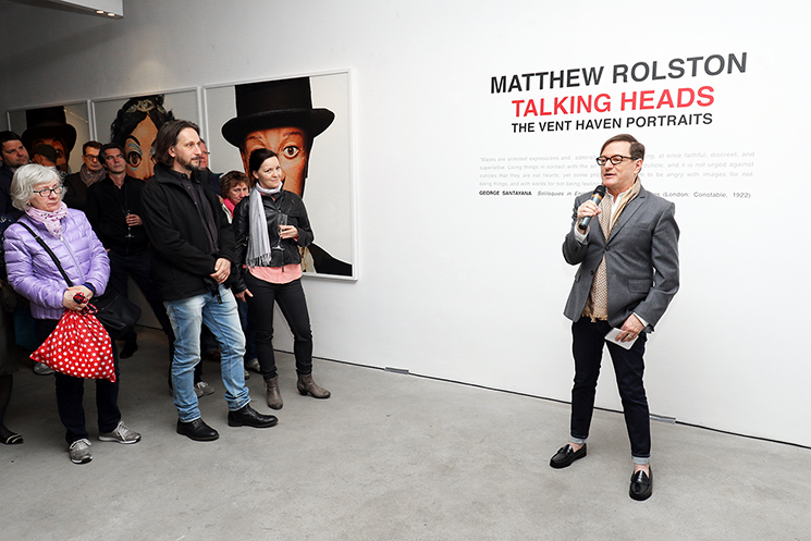 Matthew Rolston addresses guests at the Talking Heads opening reception.
