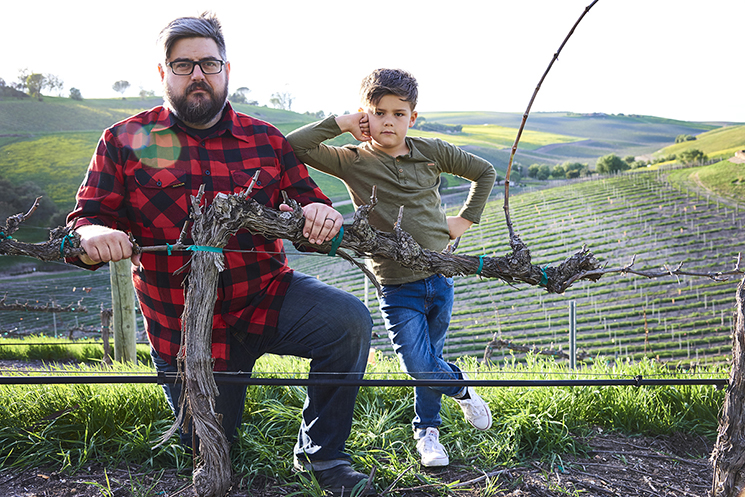 Winery owner Keith Saarloos and his son at his vineyard in Los Olivos, California.