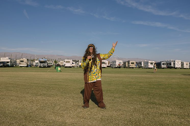 """INDIO, CA - Oct. 9: Steve Fish, of Wyoming, Rhode Island, dressed the part of a hippie today on day three of the Desert Trip music festival in Indio, California. He is a postal worker by day but says he is a """"rock 'n' roll animal."""" """"It's very thrilling to be here. I saw the lineup and said I'm not missing this. It's like the Super Bowl. It's huge."""" Photo by Brinson+Banks Model Release: YES"""