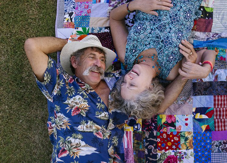 INDIO, CA - Oct. 9: Carl Fox, 60, and his wife Sonya Fox, 59, of Pioneertown, California, pose for a portrait on the general admission lawn on night three of Desert Trip music festival in Indio, California. The couple, who just celebrated their 21st anniversary, worked together in the music business years ago for Bill Graham Represents. Photo by Brinson+Banks Model Release: YES