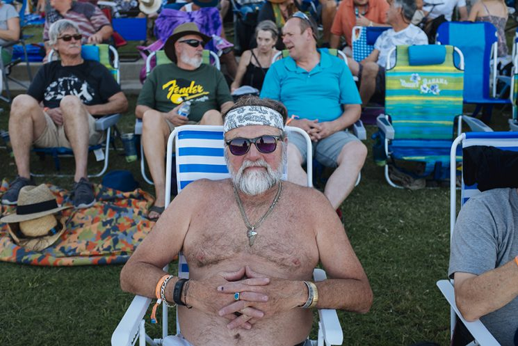 INDIO, CA - Oct. 8: Terrell Adkins, 66, of Desert Hot Springs, CA, sits on the lawn before Neil Young graced the stage. Bob Dylan, The Rolling Stones, Paul McCartney, Neil Young, The Who and Roger Waters, all performed at Desert Trip music festival in Indio, California October 8, 2016. Photo by Brinson+Banks Model Release: YES