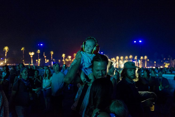 NDIO, CA - Oct. 9: A very young concert attendee takes in the performance of The Who during the final night of musical performances during the first weekend of Desert Trip Music Festival, which features bands Bob Dylan, The Rolling Stones, Paul McCartney, Neil Young, The Who and Roger Waters, in Indio, California October 9, 2016. Photo by Brinson+Banks