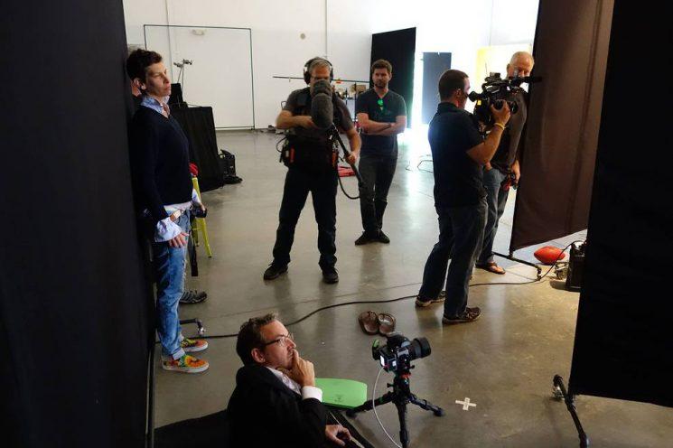 Art Streiber (left) problem-solvingon set, and Doug Menuez conferring with a client.