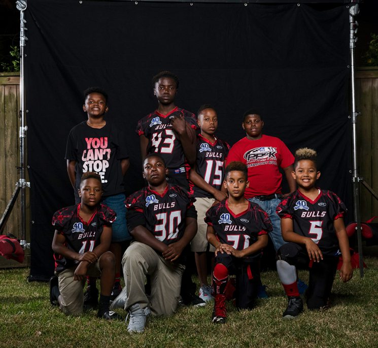 BEAUMONT, TX - OCTOBER 31: Members of the Beaumont Bulls senior youth football team poses for photos. (Walter Iooss for ESPN)