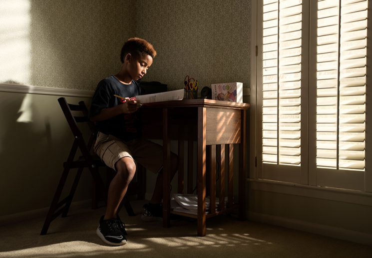 BEAUMONT, TX - NOVEMBER 01: Jaelun Parkerson sits in his home while doing homework. Jealun is a member of the Beaumont Bulls senior youth football team from Beaumont, TX. (Walter Iooss for ESPN)