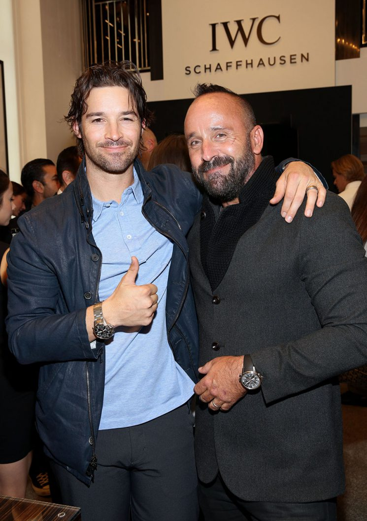 """LOS ANGELES, CA - DECEMBER 08: Photographer Michael Muller (R) and Baseball Player C. J. Wilson attend the IWC Schaffhausen watch launch of the special edition, Aquatimer Chronograph Edition """"Sharks"""" (Ref. IW379506) during an exclusive Cocktail at the IWC Schaffhausen Boutique on Rodeo Drive in Los Angeles on December 8, 2016. The special Edition is limited to 500 watches and features a special hammerhead shark engraving on the case back. The Aquatimer Chronograph Edition """"Sharks"""" is exclusively bundled with a copy of Michael Muller's book of the same name. (PPR/IWC/Photo by Rachel Murray/Getty Images)"""