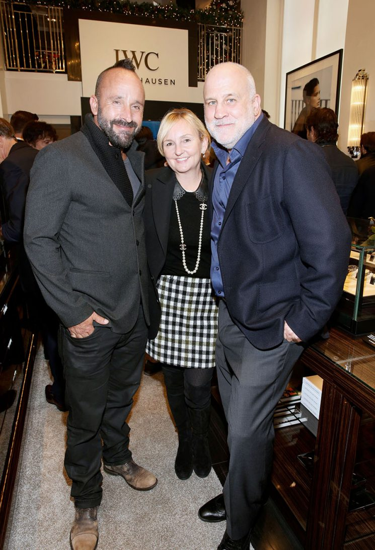 """LOS ANGELES, CA - DECEMBER 08: (L-R) Photographer Michael Muller, Colleen Saftler, and President Program Strategy and COO FX Productions Chuck Saftler attend the IWC Schaffhausen watch launch of the special edition, Aquatimer Chronograph Edition """"Sharks"""" (Ref. IW379506) during an exclusive Cocktail at the IWC Schaffhausen Boutique on Rodeo Drive in Los Angeles on December 8, 2016. The special Edition is limited to 500 watches and features a special hammerhead shark engraving on the case back. The Aquatimer Chronograph Edition """"Sharks"""" is exclusively bundled with a copy of Michael Muller's book of the same name. (PPR/IWC/Photo by Rachel Murray/Getty Images)"""