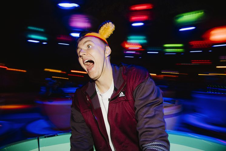 Kristaps Porzingis, of the New York Knicks, enjoys spinning in a giant tea cup on the Mad Tea Party ride in Disneyland in Anaheim, California December 10, 2016. (Brinson+Banks for ESPN)