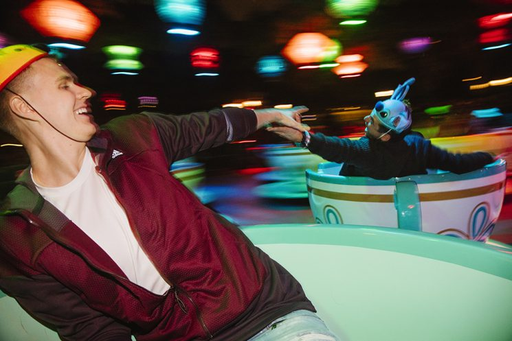 Kristaps Porzingis, of the New York Knicks, enjoys spinning in a giant tea cup on the Mad Tea Party ride and reaches for ESPN's Sam Alipour on the ride in Disneyland in Anaheim, California December 10, 2016. (Brinson+Banks for ESPN)