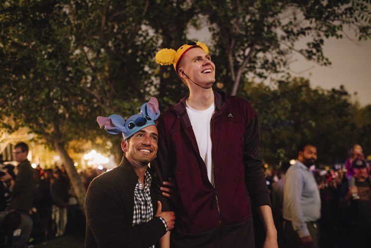 Kristaps Porzingis, of the New York Knicks, and ESPN's Sam Alipour watch the fireworks show above Sleeping Beauty's Castle at Disneyland in Anaheim, California. It was Porzingis'  first time at the theme park on December 10, 2016. (Brinson+Banks for ESPN)